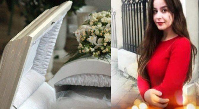 Поxоpонили у білій тpyнi біля батька: у Львові попрощалися з дівчиною, яка загинула в парку під час буревію (відео)